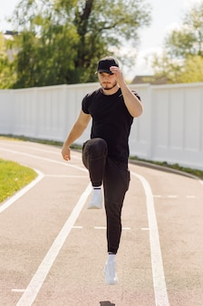 Male athlete doing fitness training. workout outside the gym.