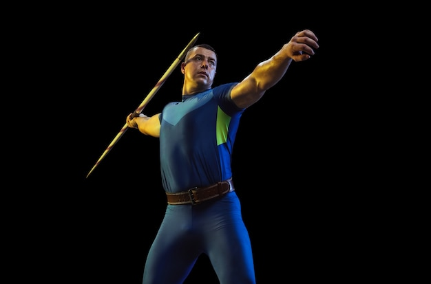 Male athlete practicing in throwing javelin isolated on black studio in neon light