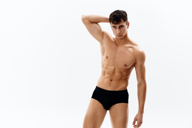 Male athletic physique dark shorts posing models