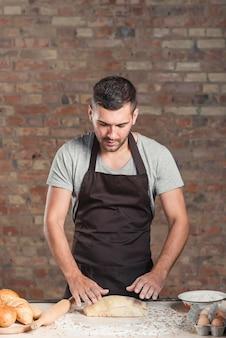 Male baker preparing the fresh dough