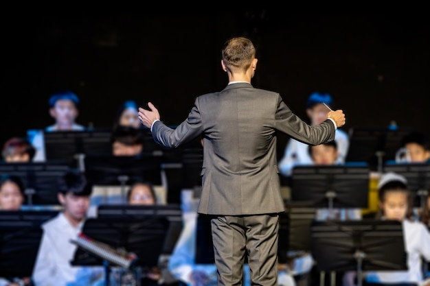 Male band conductor conducting his concert band