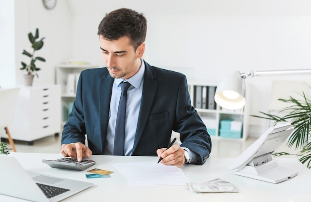 Male bank manager working in office