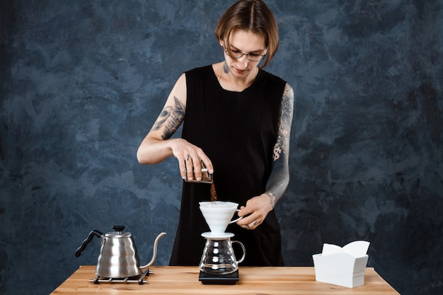 Male barista brewing coffee. alternative method pour