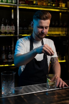 Male bartender making a delicious cocktail