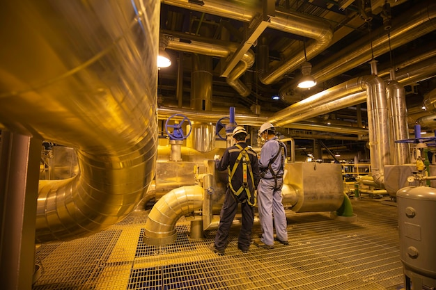 Male to be worker visual inspection inside control room valve tank pipeline power plants