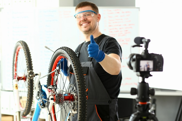 Male blogger hand service man bicycle