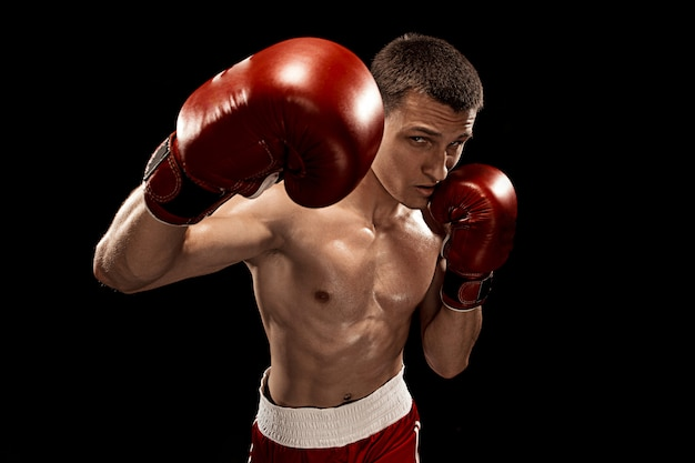 Male boxer boxing on black