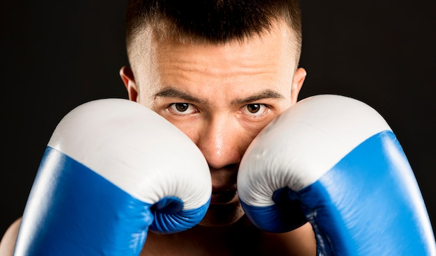 Male boxer posing with protective gloves