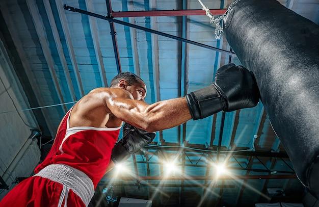 Male boxer practising