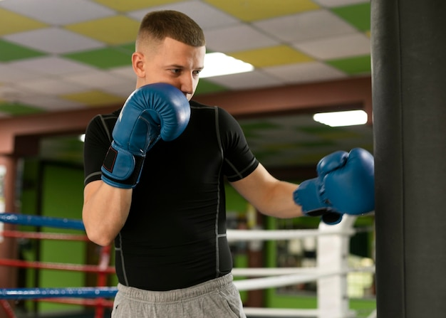 Male boxer with gloves training