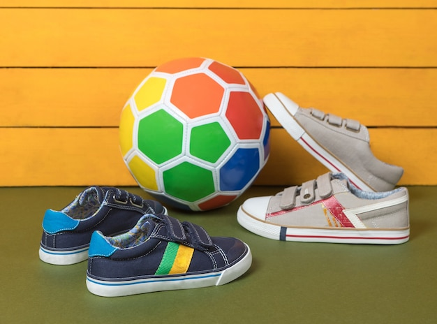 Male boy sneakers shoes with a soccer ball