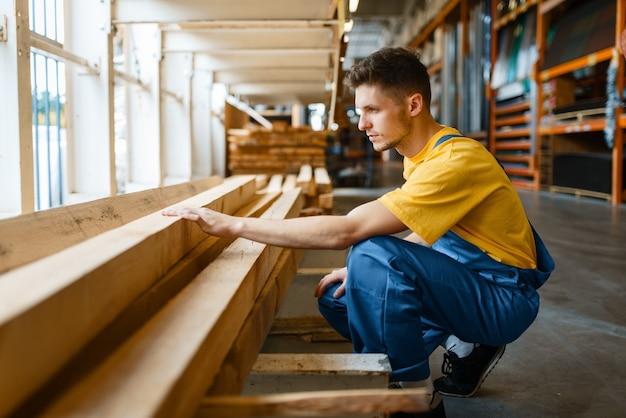 Male builder choosing repair materials in hardware store. customer look at the goods in diy shop