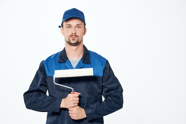 Male builder painter in construction form emotions light background