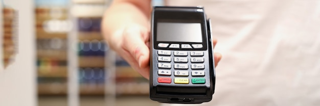 Male businessman hand hold pos terminal closeup