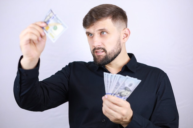 A male businessman holds money in both hands