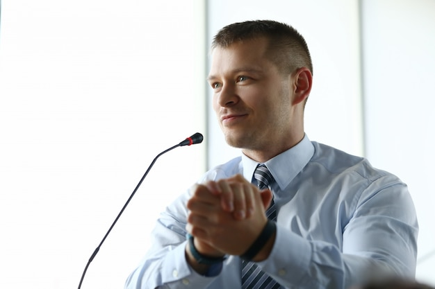 Male businessman implements progress report for year portrait.