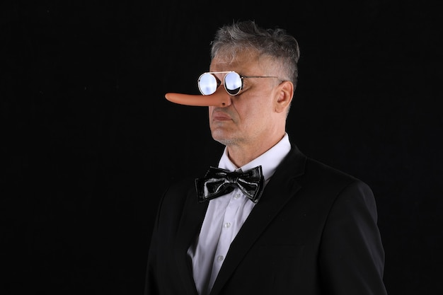 Male businessman with long nose