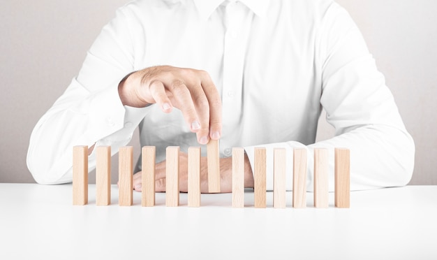 Male businessman, wooden blocks. a concept about career growth, insurance