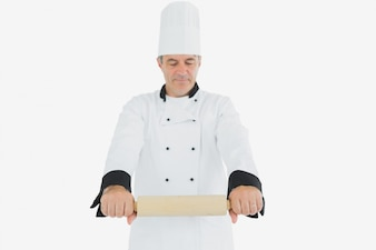 Male chef holding rolling pin