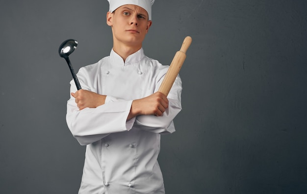 Male chef kitchenware cooking in restaurant studio.