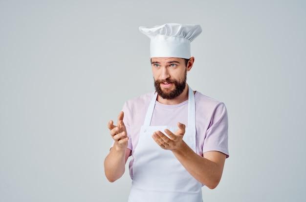 Male chef in uniform walkietalkie professional restaurant light background