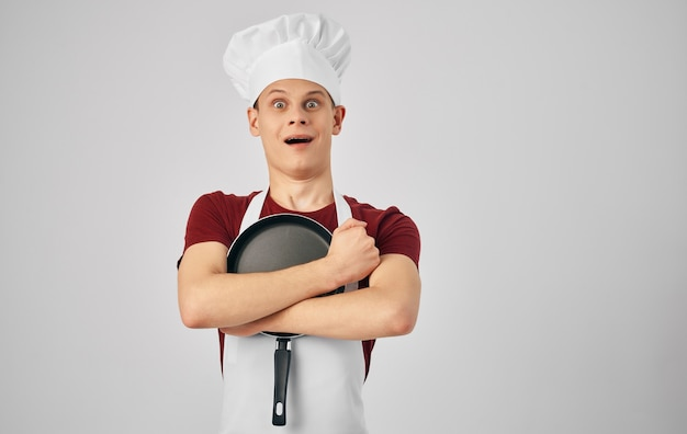 Male chef with kitchen utensils cooking food service. high quality photo