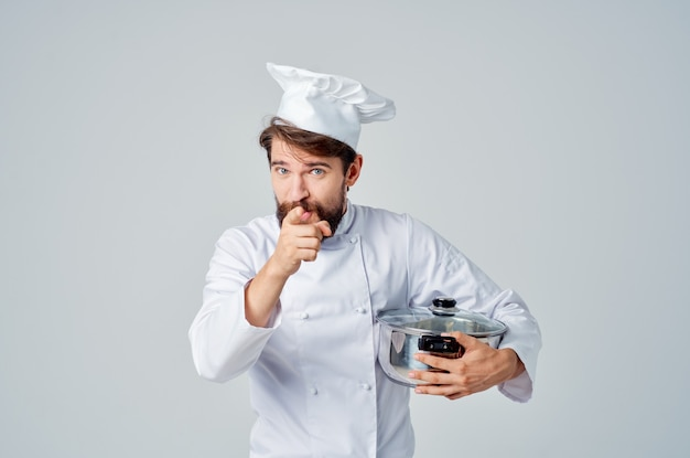 Male chef with white hat on his head restaurant kitchen service
