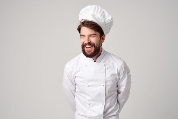 男性料理レストランサービスプロの手のジェスチャー明るい背景。高品質の写真