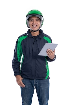 Male courier driver holding tablet pc isolated over white background