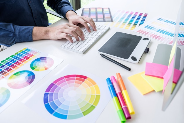 Male creative graphic designer working on color selection and color swatches