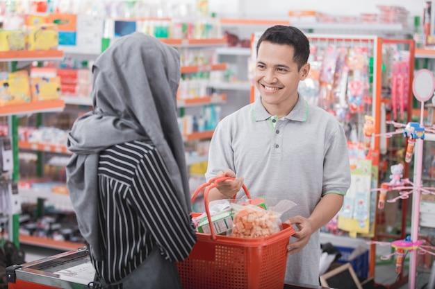 Male customer smiling to shopkeeper