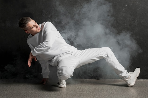 Male dancer posing with fog