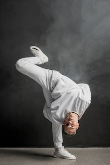 Male dancer posing with smoke