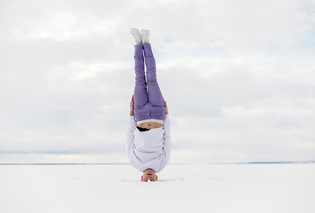 Male dancer standing on his head outside