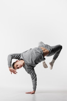 Male dancer in tracksuit dancing with copy space