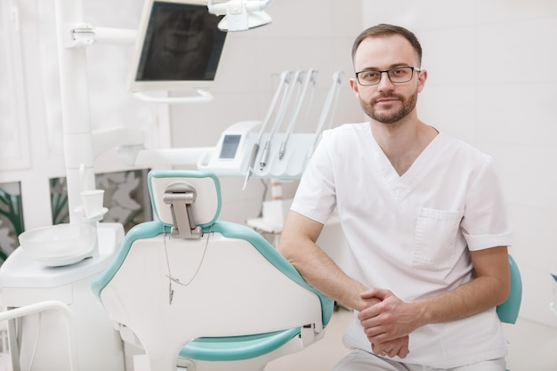 Male dentist at his dental clinic, copy space