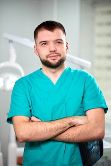 Male dentist holding x-ray