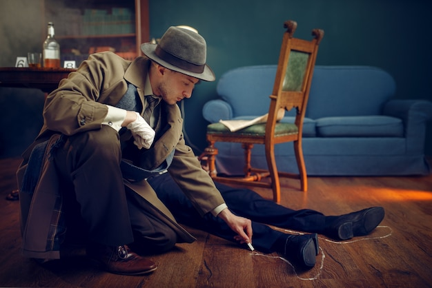 Male detective in coat circles victim's body with chalk at the crime scene, retro style. criminal investigation, inspector is working on a murder, vintage room interior