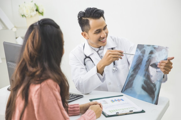 Male doctor explain something to the patient in a clinic