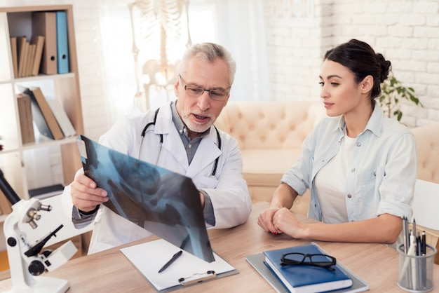 Male doctor and female patient in office