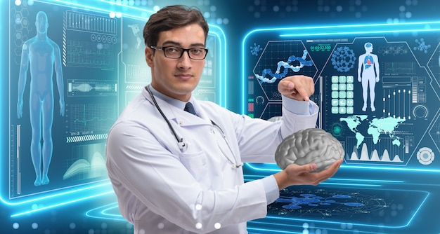 Male doctor holding a brain