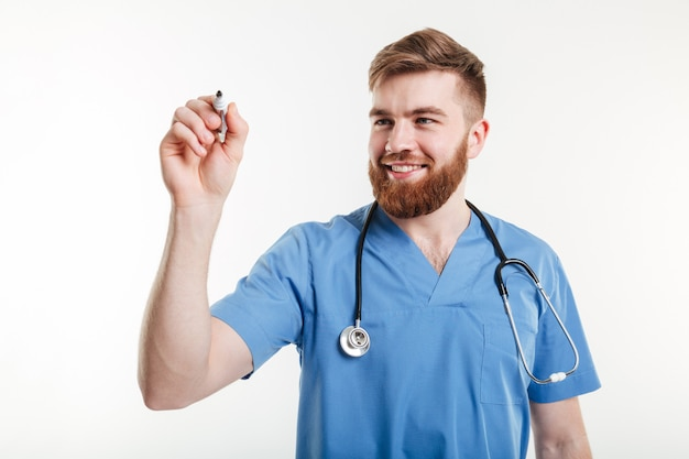 Male doctor or nurse writing with marker on a copyspace