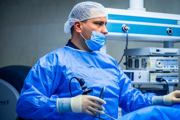 Male doctor in operating room for surgical venous vascular surgery clinic