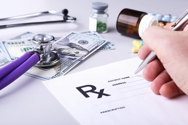 Male doctor or pharmacist holding jar or bottle of pills in hand