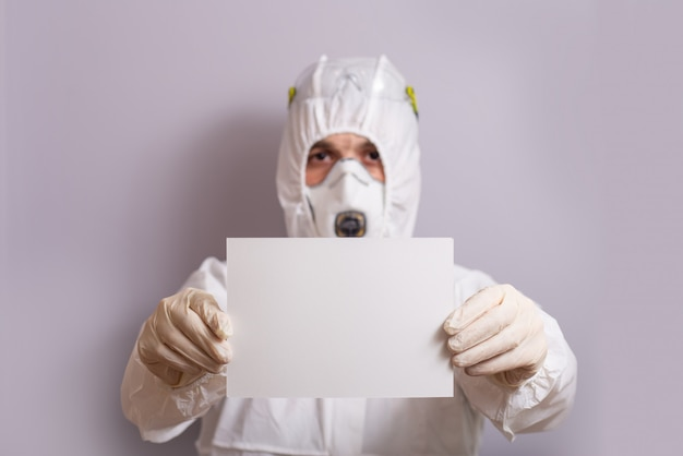 Male doctor in protective suit against bacterial and viral infection, covid 19, stop, stay at home.