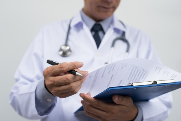 Male doctor reviewing medical report