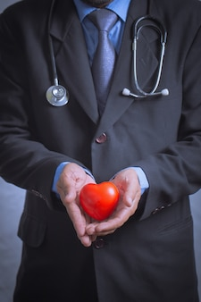 Male doctor showing stethoscope for checkup heart, heart care concept