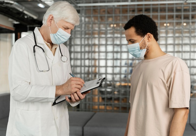 Male doctor talking with patient