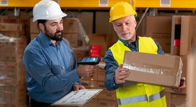 Male employees in warehouse