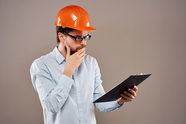Male engineer documents in hand and drawings success isolated background